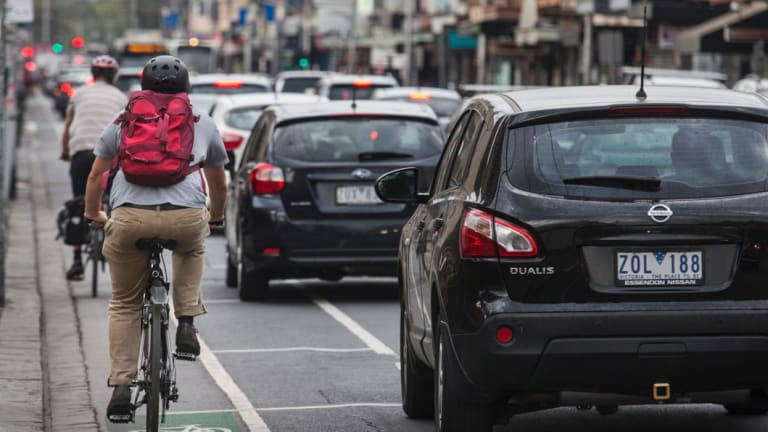 Cyclists navigate busy traffic.