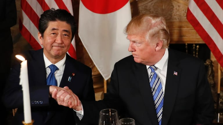 US President Donald Trump shakes hands with Japanese Prime Minister Shinzo Abe before dinner at Trump's Mar-a-Lago club last week.