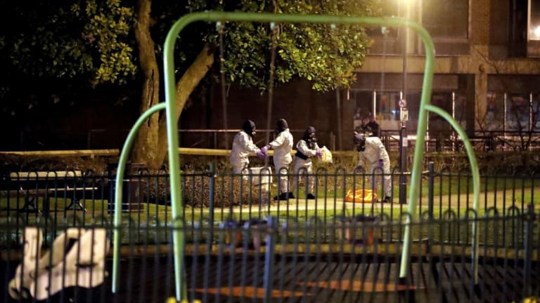 Investigators wear protective suits at the scene of the nerve agent attack in England earlier this month.