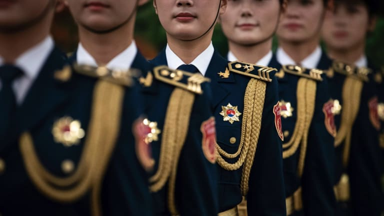 Female members of Chinese People's Liberation Army honour guard wait for the welcome ceremony for Botswana President Mokgweetsi Masisi in Beijing.