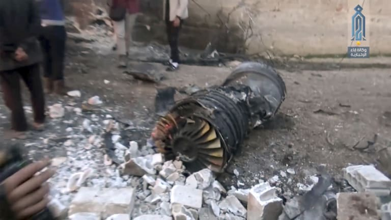 A photo supplied by al-Qaeda in Syria shows part of a Russian plane that was shot down by rebel fighters over north-west Idlib province in Syria in February.