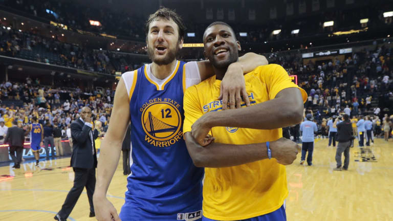 Halcyon days: Andrew Bogut celebrates with Festus Ezeli after the Warriors beat the Memphis Grizzlies in the playoffs in 2015.