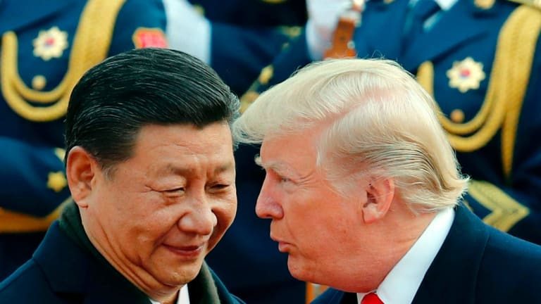 Chinese President Xi Jinping chats to Donald Trump during a welcome ceremony in Beijing in 2017.