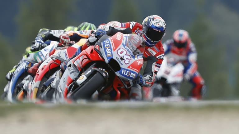 Tough battle: Italian rider Andrea Dovizioso started on pole, but was pushed the entire way.