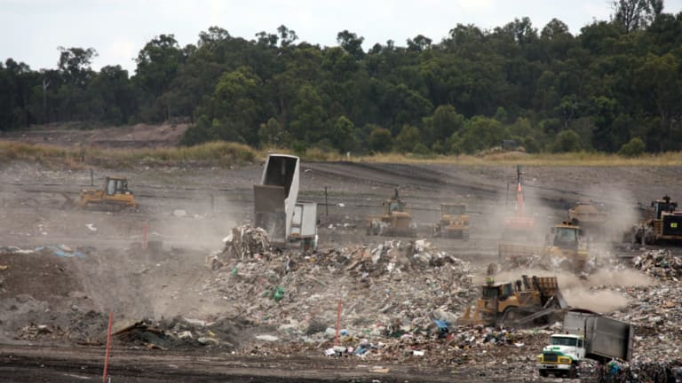 Queensland waste trucks dump unprocessed construction waste from NSW at Cleanaway's New Chum landfill in Ipswich.