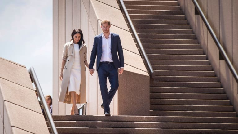 The Duke and Duchess Harry and Meghan meet the crowd outside the Opera House this week.