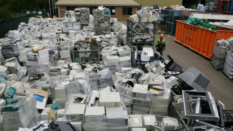 E-waste: masses of discarded computers and televisions at a recycling plant.