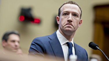 Under pressure: Mark Zuckerberg fronts a congressional hearing in April.