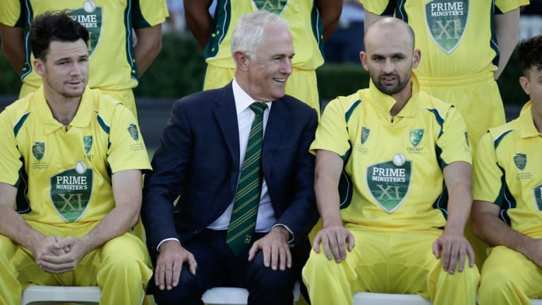 Prime Minister Malcolm Turnbull speaks with captain Nathan Lyon during a team ahead of the PM's XI cricket match against England earlier this year.