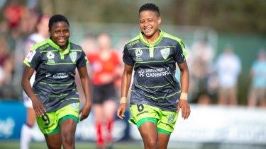 Refiloe Jane and Rhoda Mulaudzi celebrate after Jane scored her second goal against Perth Glory in round two.