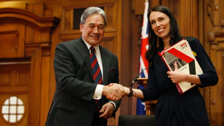 New Zealand Prime Minister Jacinda Ardern, right, with New Zealand First leader Winston Peters after signing their coalition agreement. Ardern came to power with a vow to cut migrant intake.