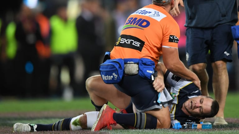 Horrible break: Shaun Fensom of the Cowboys lies injured on the pitch during the NRL grand final.