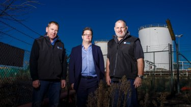 Director of Capital Recycling Solutions Adam Perry, Dean Ward from ActewAGL, and project manager Ewen McKenzie at the former Shell site marked for development as a waste recycling facility.