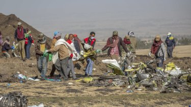 Rescuers work at the scene of an Ethiopian Airlines 737 MAX flight crash, south of Addis Ababa, in March.