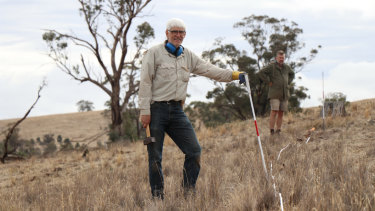 Volunteer Dr Garry McDonald (foreground) at the Nardoo Hills reserve.