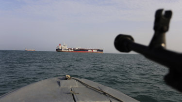 A speedboat of Iran's Revolutionary Guard trains a weapon towards the British-flagged oil tanker Stena Impero, seized in the Strait of Hormuz on July 19.