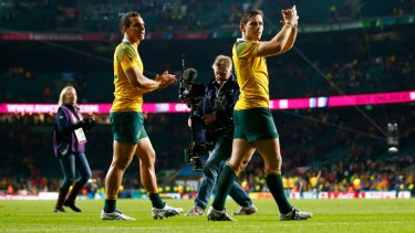 Incumbent: Bernard Foley, right,  and Matt Toomua celebrate after the 2015 Rugby World Cup Pool A match between Australia and Wales at Twickenham Stadium.
