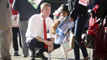Labor Candidate for the seat of Reid Sam Crosby, campaigning at Concord Public School on election morning, was beaten by Fiona Martin.
