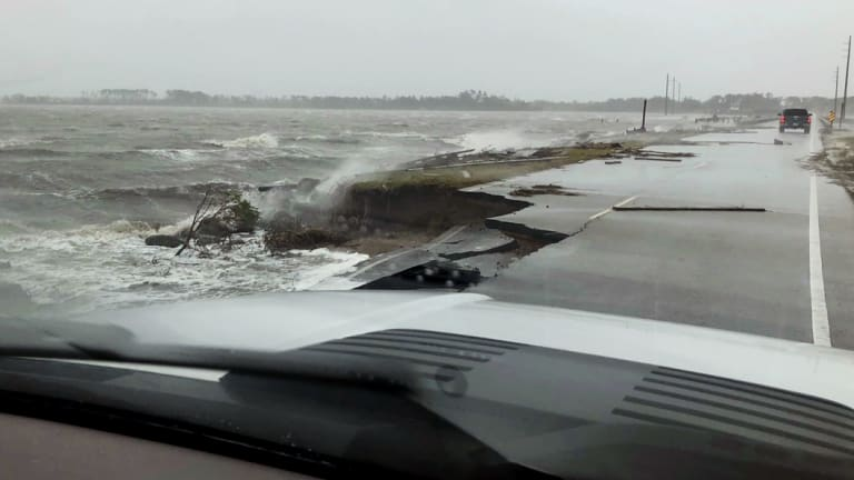 Wind and water from Hurricane Florence damaged the highway leading off Harkers Island, North Carolina.