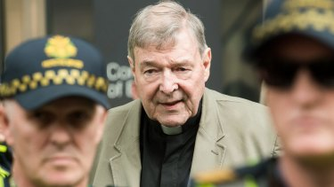 Cardinal George Pell leaves the County Court in Melbourne where was found guilty of historic sexual offences.