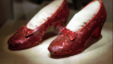 One of the four original pairs of ruby slippers worn by Judy Garland, as Dorothy, in The Wizard of Oz. A pair has been restored at the cost of $30,000.