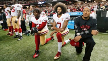 Former San Francisco 49ers quarterback Colin Kaepernick (second from right) triggered a wave of NFL players kneeling during the anthem to raise awareness of racism and social injustice. He was later dumped by the NFL.