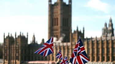 British Union flags fly in front of The Houses of Parliament in London.