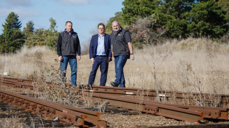 Director of Capital Recycling Solutions Adam Perry, Dean Ward from ActewAGL, and project manager Ewen McKenzie at the former Shell site, which planned to use the railway to export recyclables.
