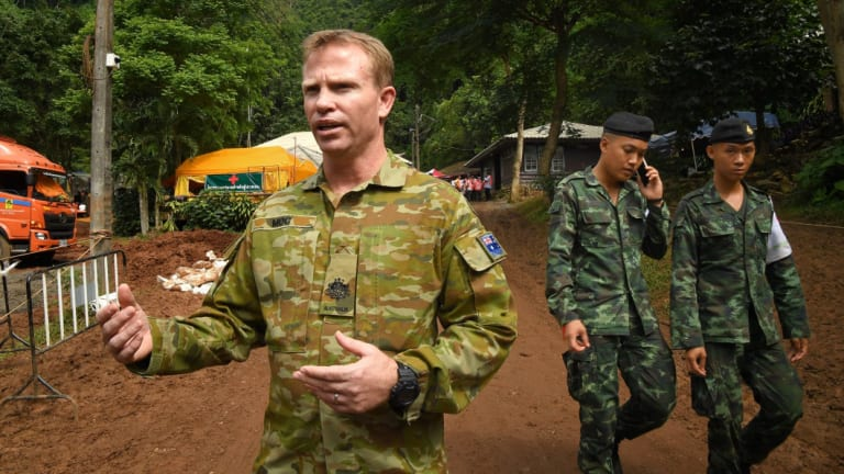 Australian military warrant officer Chris Moc, right, at the base camp where the rescue operations are being planned.