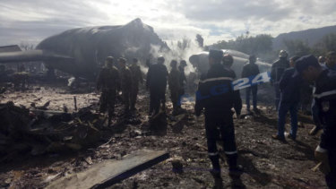 Algerian emergency services attend the crash.
