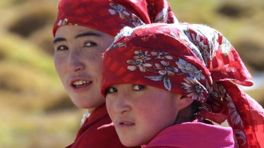 Two ethnic Kyrgyz women in the Karakorum mountain range in China's western Xinjiang province. The area, close to China's borders with Afghanistan, Pakistan and Tajikistan, is populated by a variety of ethnic groups.