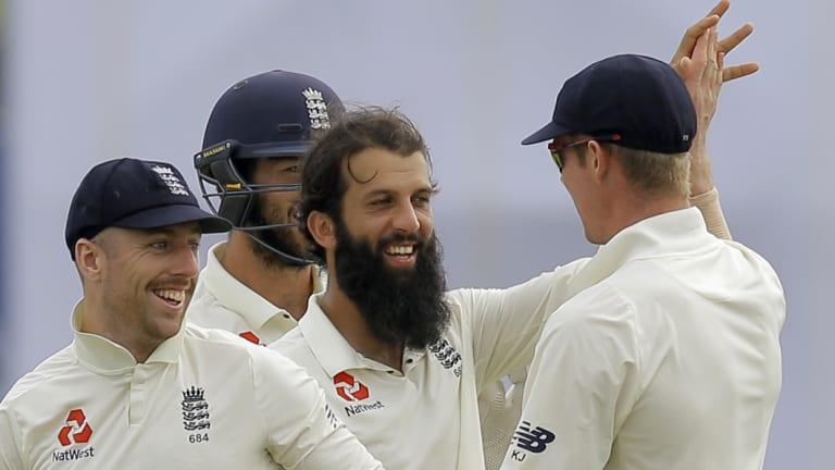 Dominant: England's Moeen Ali celebrates the dismissal of Sri Lanka's Niroshan Dickwella.