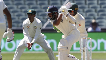 Patience of a monk: Cheteshwar Pujara fights a lone hand for India on day one of the first Test.