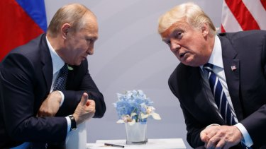 Russian President Vladimir Putin meets US President Donald Trump.