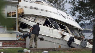 An insurance adjuster looks over a storm-beached yacht in North Carolina after Hurricane Florence came through on September 20.
