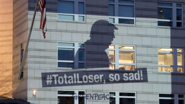 A Greenpeace image showing the shadow of US President Donald Trump, who pulled the US out of the Paris Agreement, is projected onto the facade of the US embassy in Berlin last June.