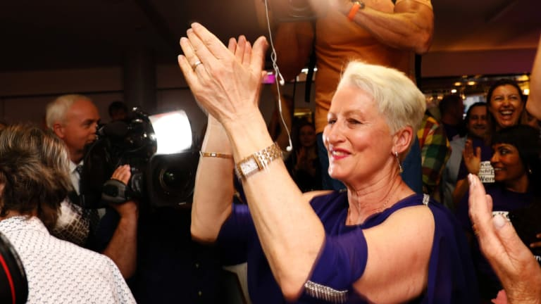 Independent candidate for Wentworth Kerryn Phelps is congratulated by supporters as she arrives for a Wentworth by-election evening function at North Bondi Life Saving Club, Sydney.