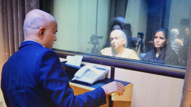 Jailed Indian naval officer Kulbhushan Jadhav, left, meets with his mother (centre) and wife in an Islamabad prison in 2017.