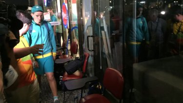 Archer Alec Potts walks to the judge's chambers after hours of questioning by police at the Rio Olympics.