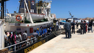 Rescued migrants desembark from the Mare Jonio rescue ship of the Italian NGO Mediterranea Saving Humans as it docked at the port of the Italian island of Lampedusa, southern Italy.