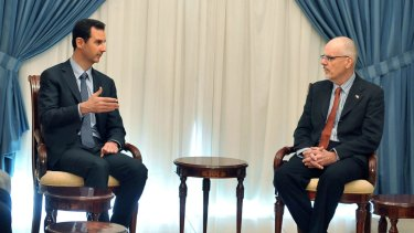 Syrian President Bashar al-Assad meets Australian academic Tim Anderson in Damascus, in a photo released by Syrian news agency SANA.