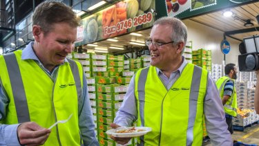 Craig Laundy and Scott Morrison, then treasurer, visit the Sydney Markets in Homebush in 2017.