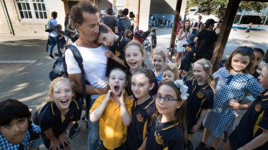 P&C president Rob Keldoulis with his son Archie and other students at Bondi Beach Public School.