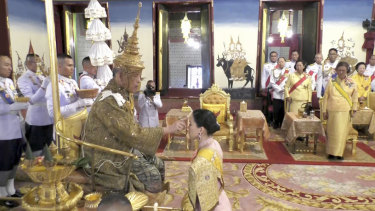 The king's wife, Queen Suthida, participates in a ritual at the Grand Palace in Bangkok during his coronation.