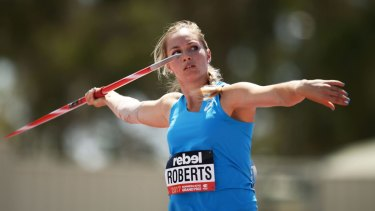 Kelsey-Lee Barber, pictured, has qualified for the world athletic championships in Doha after a 62 metre throw in Sydney on Thursday.