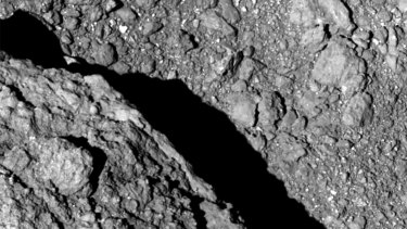 An image taken at an altitude of 64 metres from Hayabusa 2 shows the surface of asteroid Ryugu.
