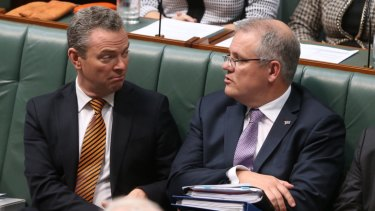 Christopher Pyne and Scott Morrison listen to prime minister Tony Abbott during question time in June 2015.