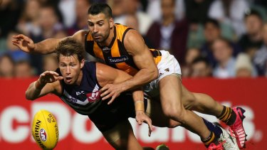 Paul Puopolo breathes down the neck of Docker Lee Spurr in 2015.