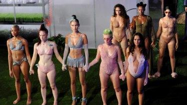 Bella Hadid (centre) and fellow models wear Savage x Fenty fashions during New York Fashion Week in 2018.