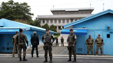 US and South Korean soldiers, foreground, and North Korean soldiers, background, stand guard in Paju, near Taesung in the DMZ, South Korea.